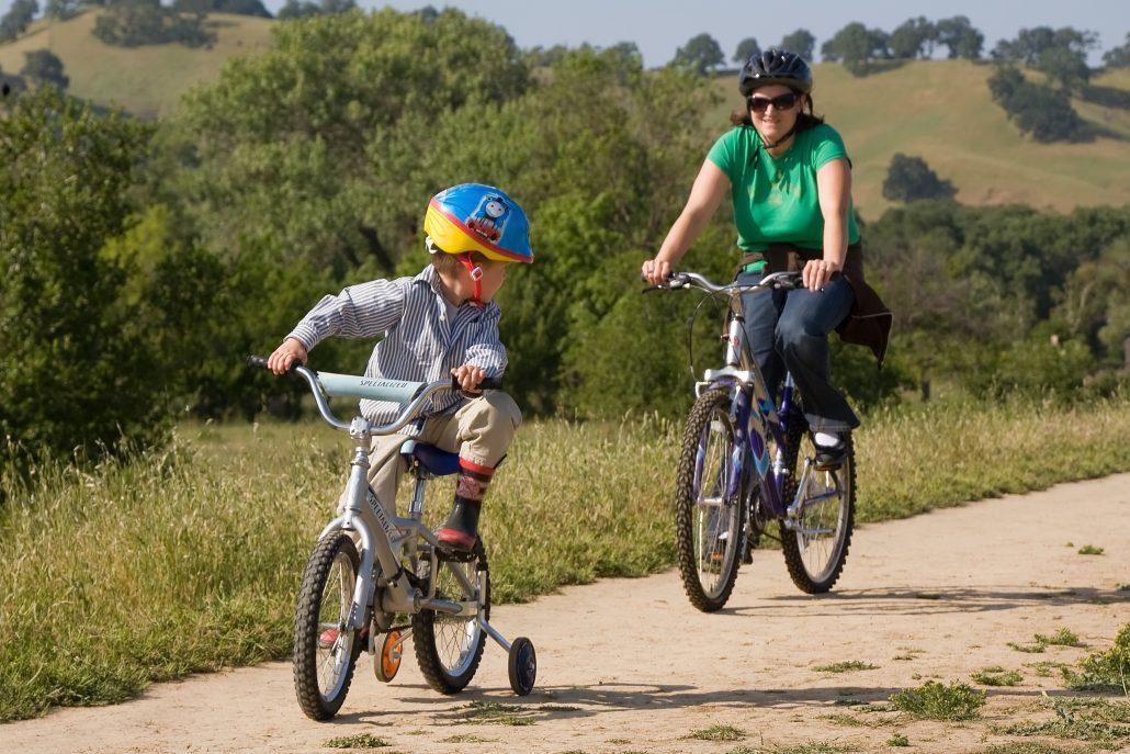 Mentor and boy Biking
